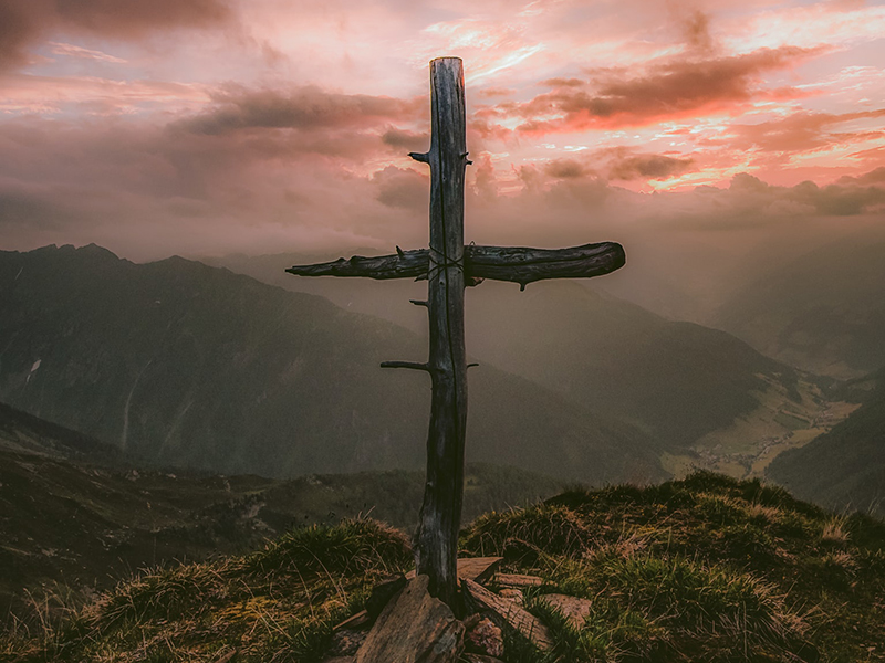 Easter image with cross on the mountain
